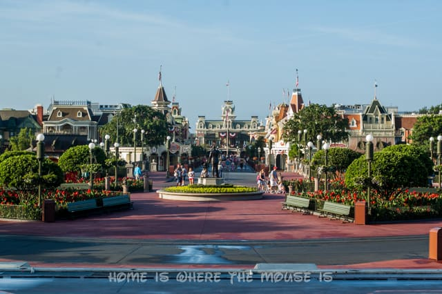 The streets of WDW's Magic Kingdom theme park are still wet in the early morning from being washed during the night.