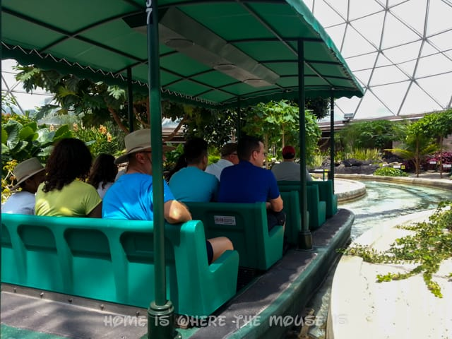 A boat takes Guests through the innovative gardens of the Living with the Land attraction in Epcot