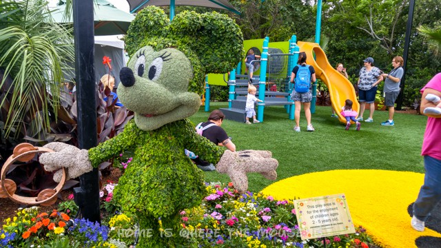 Minnie Mouse in Topiary adorns the landscape in front of this Epcot Playground